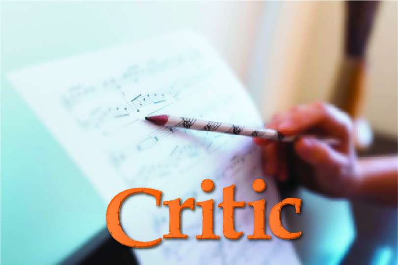An IB DP Music student holds a pencil against sheet music while labeled music critic